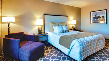 An extended room with a king size bed at Zia Park Casino, Hotel and Racetrack..